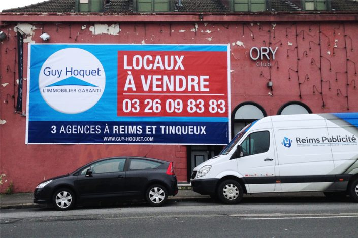 Bâche grand format immobilier guy hoquet communication