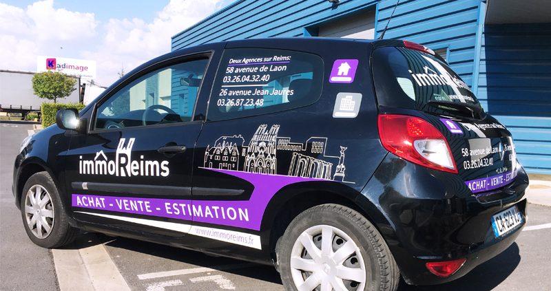 Marquage véhicule réalisé sur voiture en semi covering pour Immo Reims