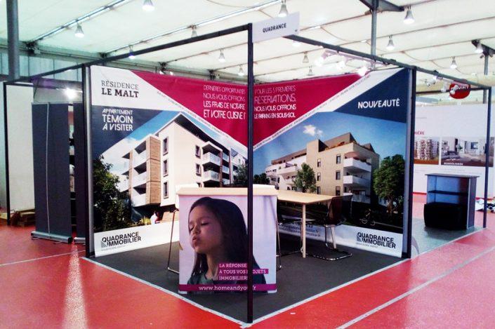stand quadrance immobilier signalétique communication bâche salon foire expo