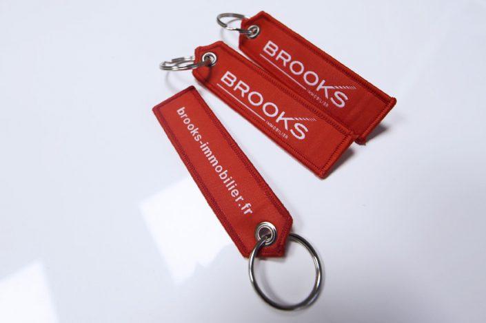 objets publicitaires goodies porte clés tissé haute précision brooks immobilier communication publicité