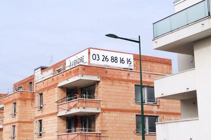 bâche grand format foyer rémois immo immobilier impression pose communication publicité signalétique