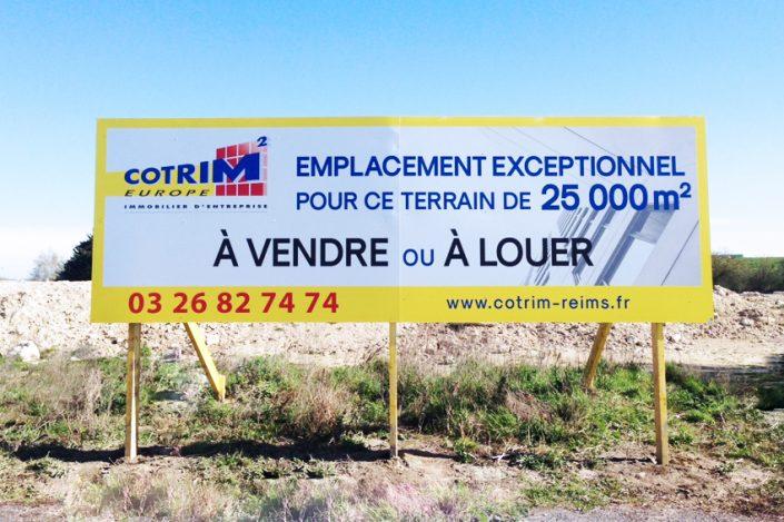 réalisation et pose panneau grand format 6x2 m cotrim europe signalétique communication publicité immo immobilier entreprise