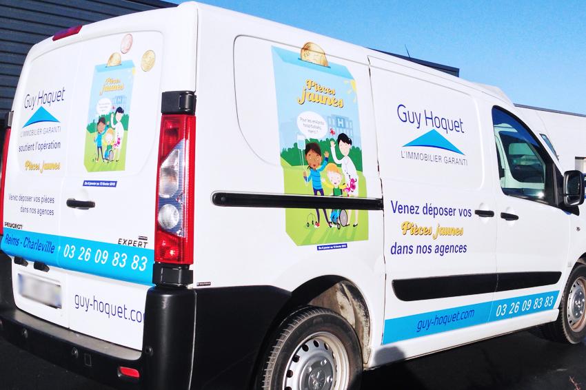 marquage véhicule adhésifs utilitaire guy hoquet immo immobilier opération pièces jaunes communication publicité