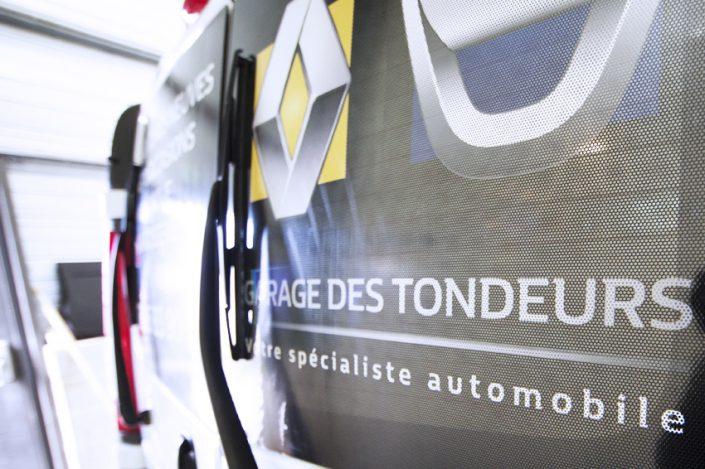 marquage véhicule adhésif microperforé garage des tondeurs communication publicité