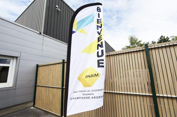 oriflamme publicitaire drapeau signalétique fnaim affichage dynamique communication reims publicité