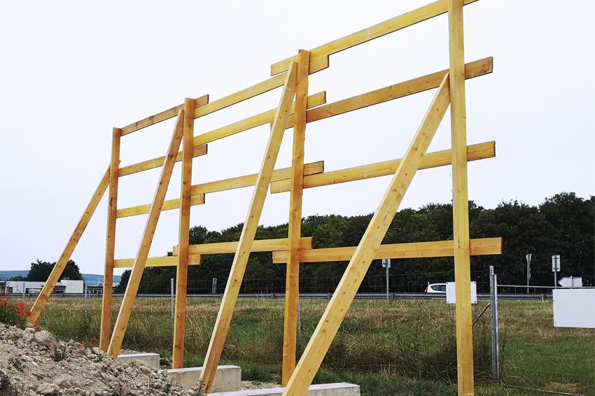 panneau grand format 9x3 m signalétique cushman & wakefield immobilier structure bois communicatin publicité