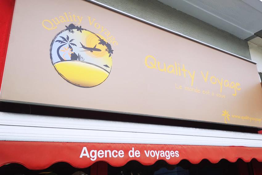 réalisation et pose d'enseignes et d'adhésifs pour Quality Voyage Charleville-Mézières
