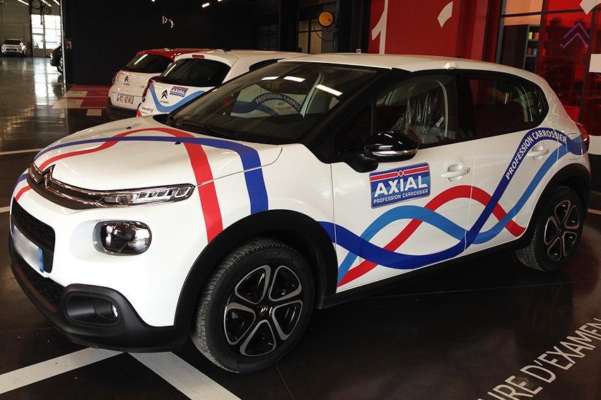 axial carrosserie marquage véhicules citadines adhésifs reims publicité